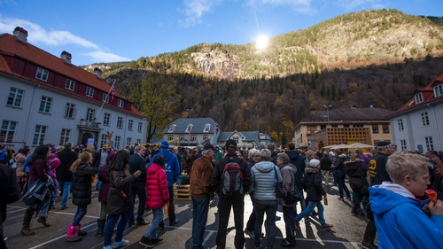 Crowds turned out in the main square in Rjukan to see the light shine down from the moutain