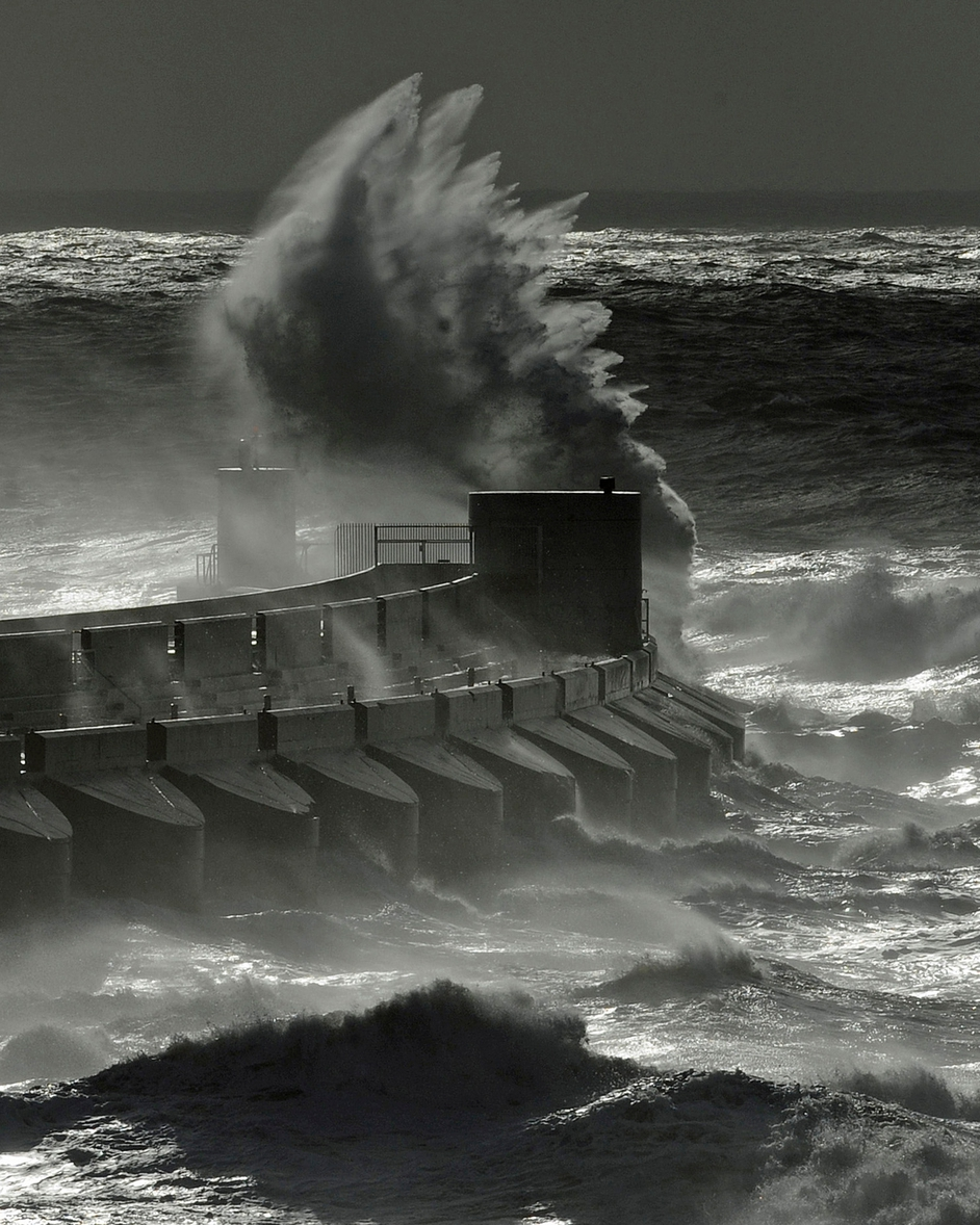 Rough seas pound Brighton Marina, southern Britain, on 28 October, after a storm hit overnight
