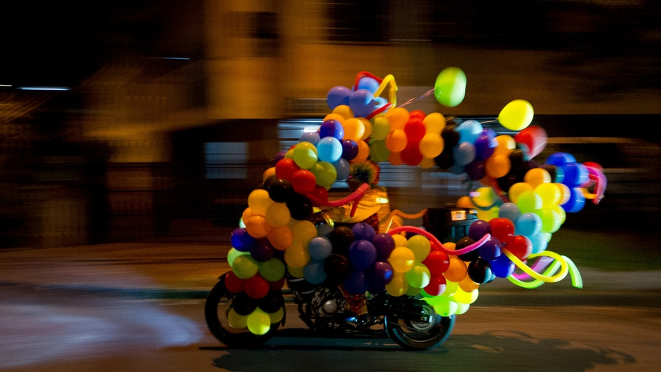 A man dressed as a clown riding his motorcycle during 'Moto-Halloween Party 2013' in Cali, Valle del Cauca department, Colombia