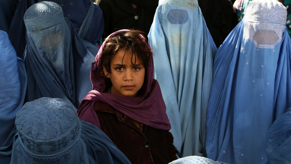 Afghan women wait to receive medical treatment at a local hospital in Kabul, Afghanistan