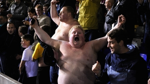 Bare-chested Stoke fans celebrate after Stoke win 4-2 on penalties during the Capital Cup Fourth Round game between Birmingham City and Stoke City