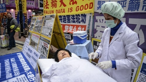 A protest with a mock operation earlier this year in Hong Kong against forced organ harvesting in China
