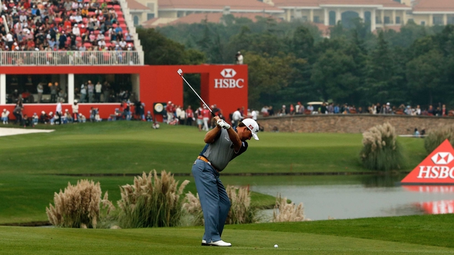Graeme McDowell hits into the 18th after an impressive third round in Shanghai