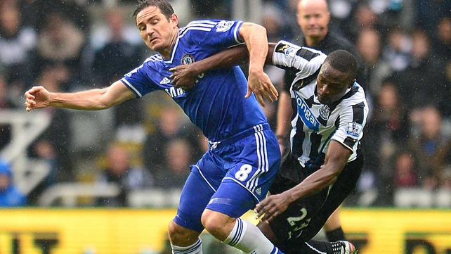 Chelsea's Frank Lampard (left) and Newcastle United's Shola Ameobi battle for possession