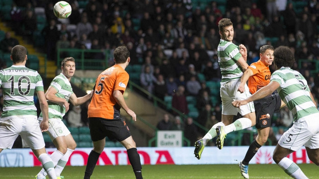 Celtic's Charlie Mulgrew scores to secure a draw against Dundee United