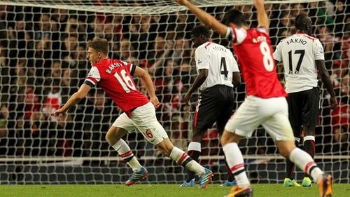Aaron Ramsey turns to celebrate after scoring Arsenal's second goal