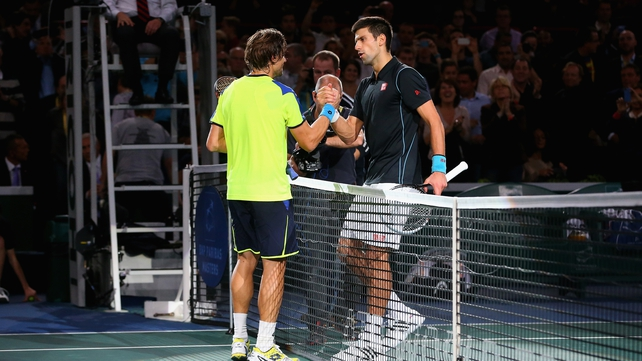 Novak Djokovic of Serbia is congratulated by David Ferrer of Spain in the final after Djokovic won in straight sets