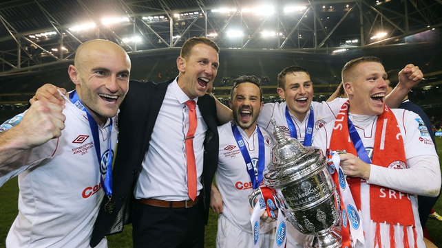 Manager Ian Baraclough celebrates with his players including Danny North (far right)