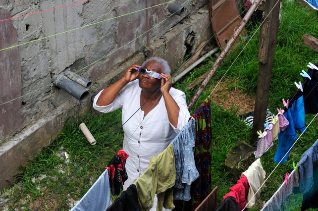 Woman in Gabon looks at eclipse
