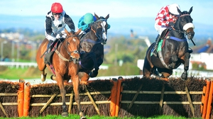 Oscar Fortune ridden by Tony McCoy (l) goes on to win the Mr & Mrs Handley Ruby Wedding Novices' Hurdle