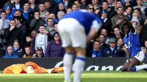 Tottenham goalkeeper Hugo Lloris lies prone on the Goodison Park turf after losing consciousness following a collision with Everton's Romelu Lukaku last season