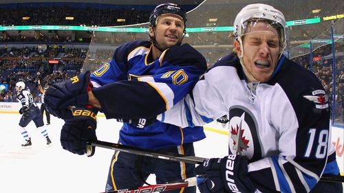 Winnipeg Jets' Bryan Little reacts after being punched by Brenden Morrow of the St. Louis Blues in St. Louis, Missouri
