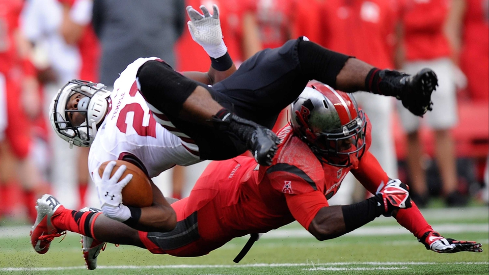 Zaire Williams of the Temple Owls and Rutgers Scarlet Knights' Delon Stephenson tangle during the third quarter at High Point Solutions Stadium in Piscataway, New Jersey