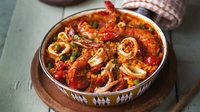 Spicy Seafood Paella - What I love most about this recipe is that a big steaming pan of food is served straight to the table and people just dig in. It also makes a great leftover lunchbox - if you're lucky enough to have any left.