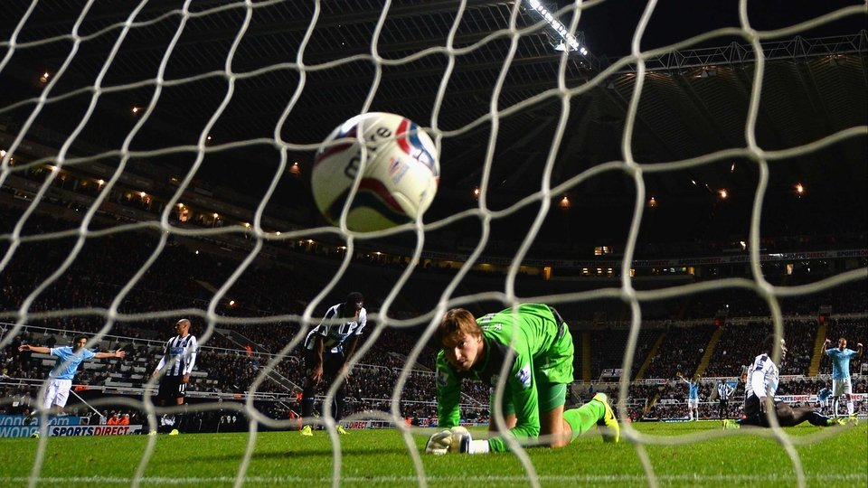 Tim Krul of Newcastle United watches the ball go into the net after Álvaro Negredo of Manchester City scored in the Capital One Cup at St James Park