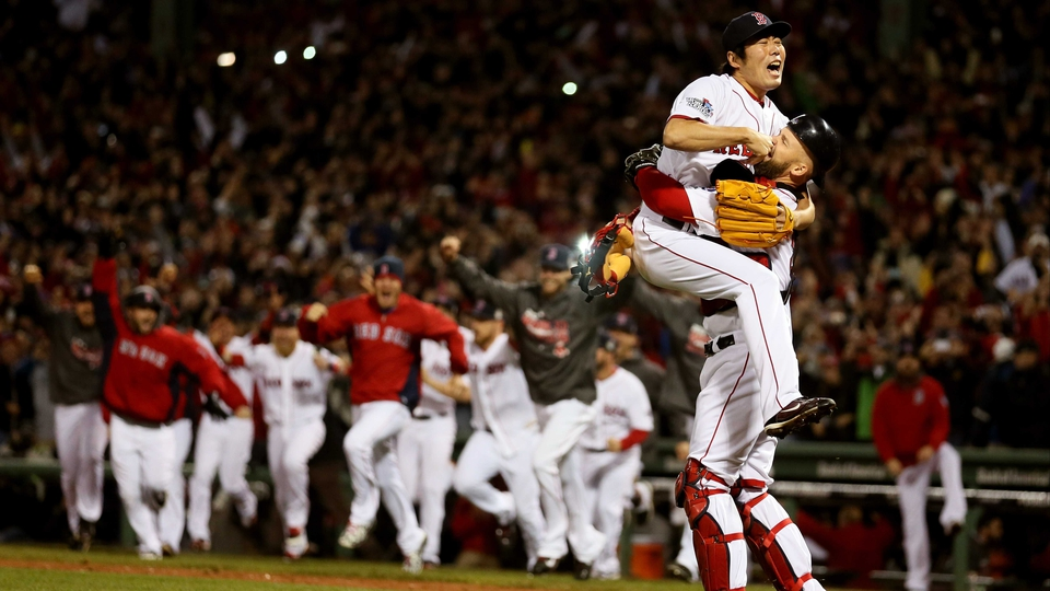 David Ross and Koji Uehara embrace as Boston Red Sox win the World Series at Fenway Park in Boston, Massachusetts