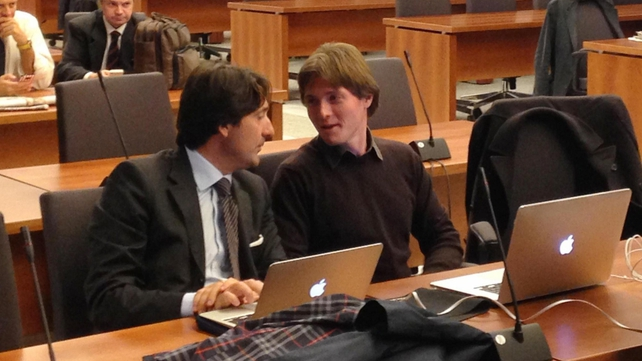 Raffaele Sollecito (R) sits in the courtroom waiting for the hearing to begin