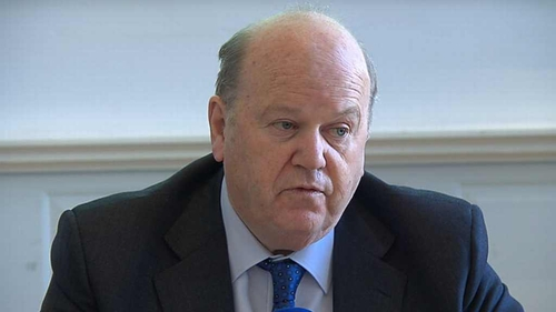 Michael Noonan has said workers in Ireland on modest incomes are hitting the top tax rate too quickly