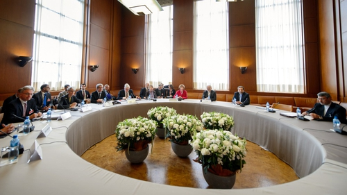 Participants gather before the start of two days of closed-door nuclear talks in Geneva