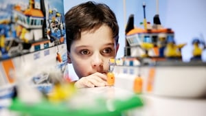 Nine-year-old Harry Collett plays with a Lego Coast Guard Patrol set at a media event in the UK as the top Christmas presents for 2013 are revealed