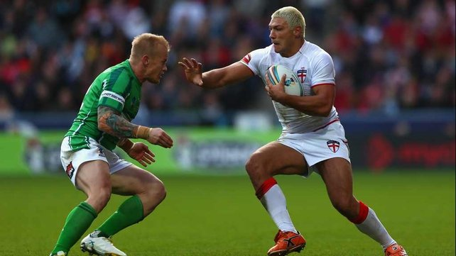 Ireland's Damien Blanch prepares to tackle Ryan Hall (right) of England during their Rugby League World Cup clash