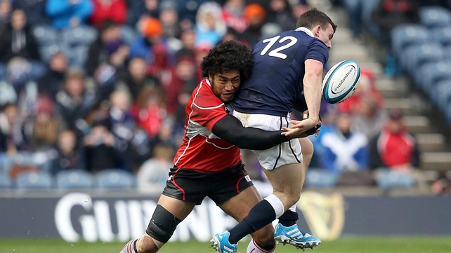Ryu Koliniasi Holani of Japan tackles Scotland's Matt Scott