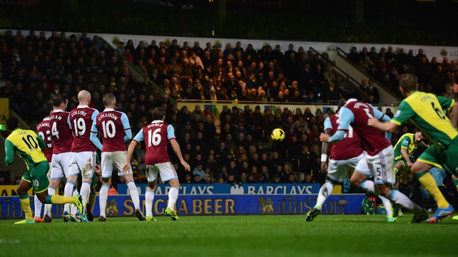 An obscured Robert Snodgrass scores Norwich's second goal from a free-kick