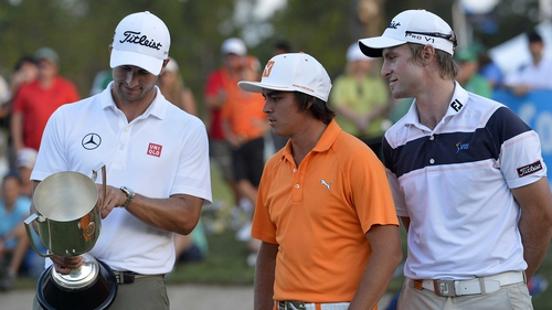 Adam Scott, Rickie Fowler and Jack Wilson share a moment after Adam Scott is presented with the winners trophy