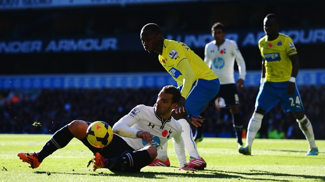Tottenham's Roberto Soldado and Mapou Yanga-Mbiwa of Newcastle United challenge for the ball