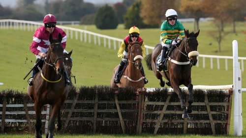 Minella Foru ridden by Tony McCoy (far right) comes home to win the second race of the day