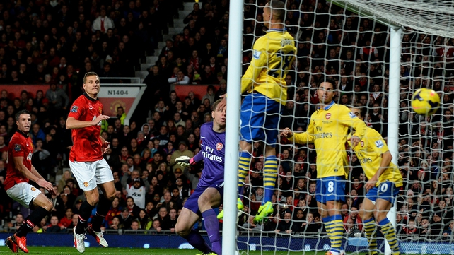 Robin van Persie's (l) header flies into the Arsenal goal