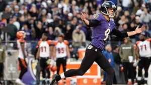 Justin Tucker celebrates after kicking the game-winning field goal against the Cincinnati Bengals