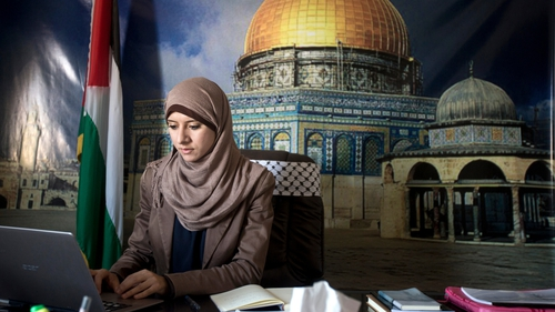 Isra Al-Modallal's job is to convey the views of the Hamas government