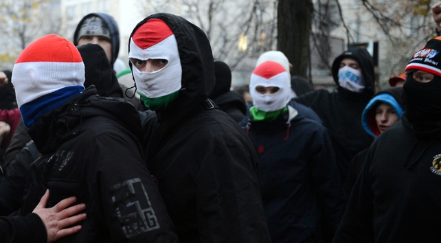 A few dozen youths, their faces covered by balaclavas and football scarves, broke off from the procession into a side street and started attacking a building where left-wing radicals occupied a squat