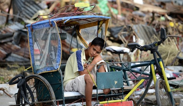 Rickshaw driver ready for business despite the devastation