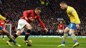 Thomas Vermaelen tracks a Wayne Rooney run