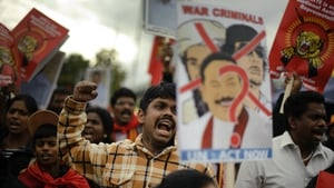 A Tamil activist reacts during a demonstration in 2011 at the UN's European headquarters in Geneva calling for a probe into alleged war crimes committed by Sri Lanka