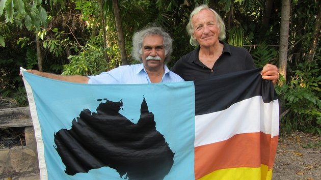 Flagging the awful truth about the plight of Aborigines today - John Pilger and friend