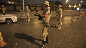 Egyptian troops keep watch at a checkpoint during the curfew hours in Cairo last August