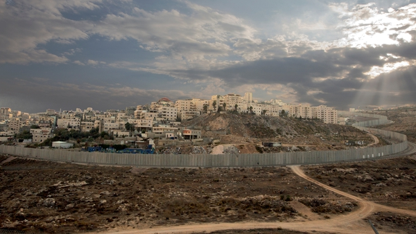 Israel's controversial separation barrier surrounds the Ras Khamis neighbourhood of East Jerusalem