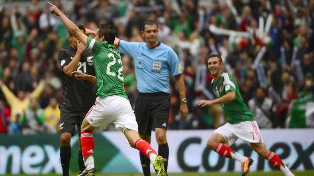 Paul Aguilar (l) and Miguel Layun celebrate after Aguilar opened the scoring