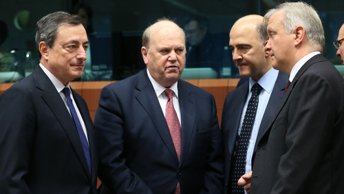 (L-R) ECB President Mario Draghi, Michael Noonan, French finance minister Pierre Moscovici and Olli Rehn at the meeting of eurozone finance ministers