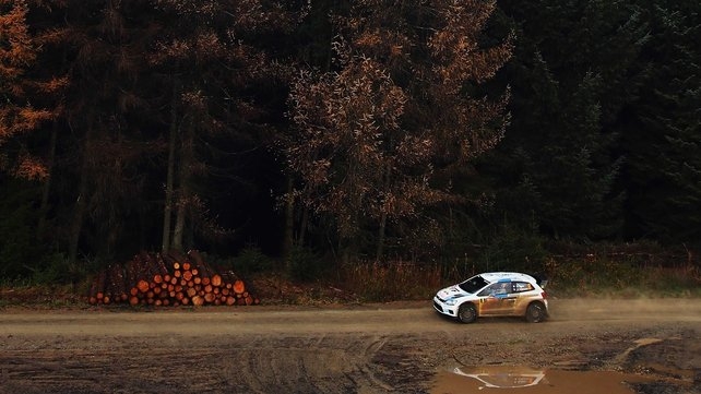 Sebastien Ogier guides his Volkswagen Polo R WRC car through the forests of Llandegla