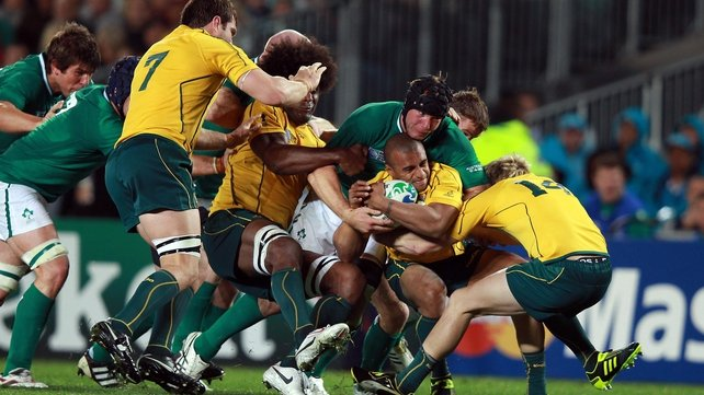 Stephen Ferris carries Will Genia towards his own line after a dominant Irish scrum during the RWC 2011 clash