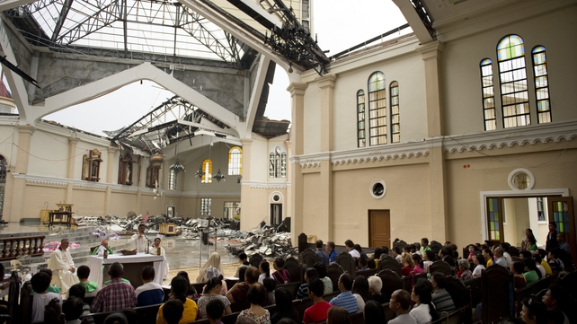 Mass is celebrated at the destroyed Catholic cathedral in Palo
