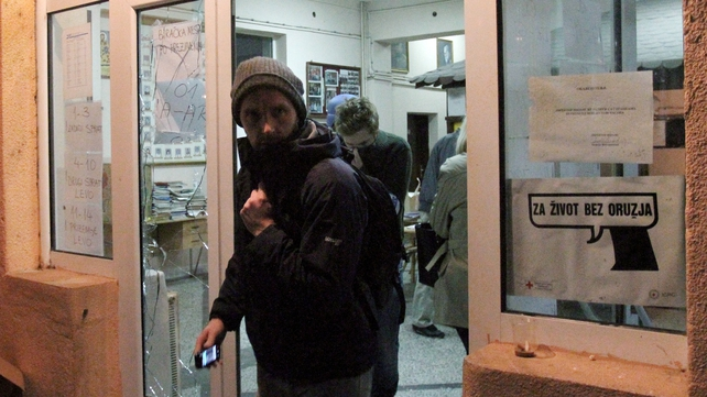 International observers leaving a polling station in Mitrovica attacked by masked men a fortnight ago