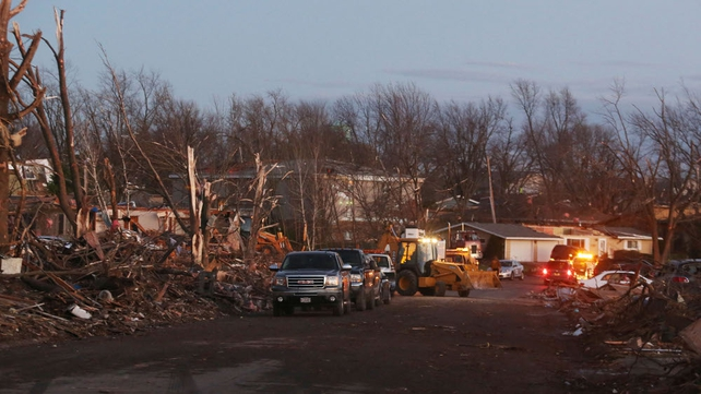 Damage is surveyed along Elgin Avenue in the town