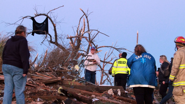 Elgin Avenue residents sort through debris in the aftermath of the storm