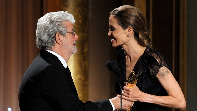 George Lucas presents Angelina Jolie with her Oscar