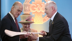 Prince Philip examines a hurley during the visit to Croke Park